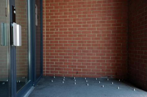 A picture shows short metal spikes designed to stop homeless people sleeping outside the entrance of a residential building in south London on June 10, 2014 (AFP Photo/Carl Court)